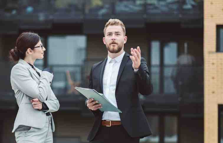 What is the difference between a real estate agent and a real estate developer?